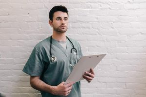 male-doctor-holding-clipboard (1)